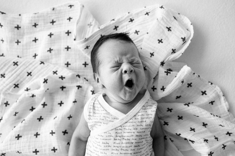 cute newborn baby yawn